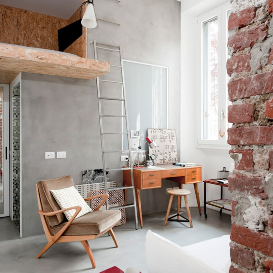 Vintage Industrial Room with Big Windows and Brick Post